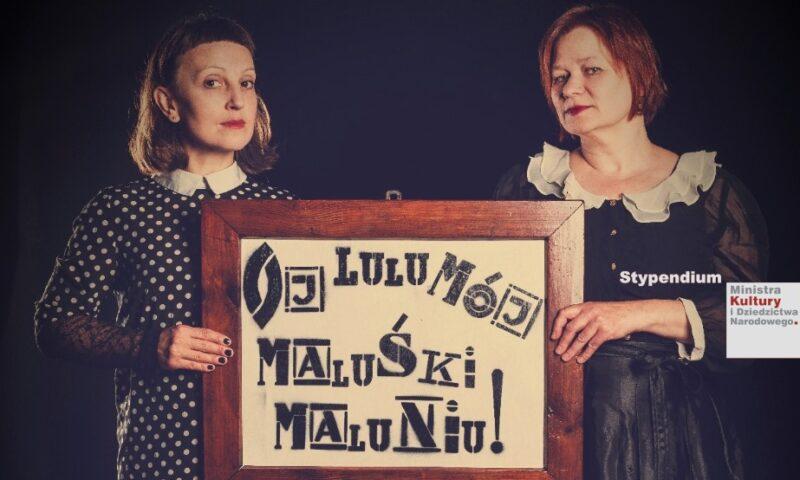 """Aktorki z tablicą z napisem """"Oj lulu mój maluśki maluniu!"""""""